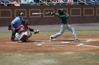 Outfielder McDaniel swings.